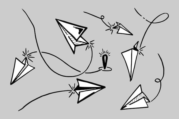 Набор значка самолетик бумаги каракули. рука рисовать бумажный самолетик. векторные иллюстрации.