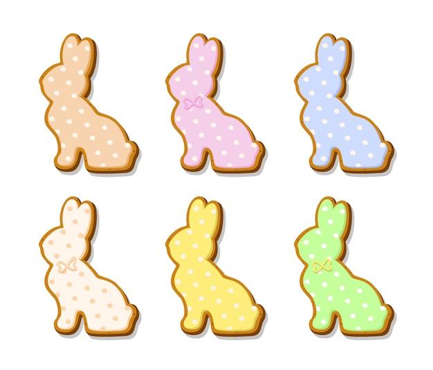 토끼의 형태로 부활절 쿠키 세트입니다. 흰색 배경에 분리된 색 파스텔 글레이즈가 있는 진저 쿠키. 종교의 휴일입니다. 벡터 일러스트 레이 션