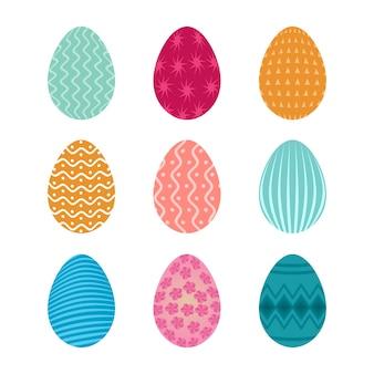 파스텔 색상의 귀여운 패턴으로 부활절 달걀의 집합 프리미엄 벡터