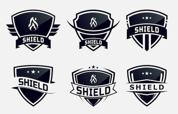 エンブレムまたはバッジの黒い盾のセット。ロゴデザイン
