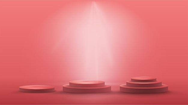 Набор пустых круглых подиумов на красной сцене.