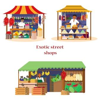 Множество экзотических уличных магазинов с продавцами