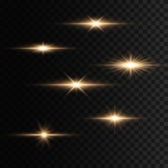 フラッシュ、ライト、スパークルのセット。明るい金が光り輝きます。抽象的な黄金色のライトが分離されました。明るい光線。輝くライン。
