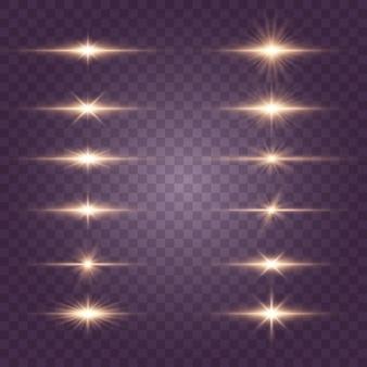 フラッシュ、ライト、スパークルのセット。明るい金色の閃光とまぶしさ。抽象的な金色の光は、明るい光線を分離しました。