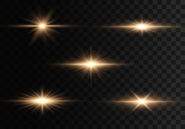 フラッシュ、ライト、スパークルのセット。明るい金が光り輝きます。明るい光線。 Premiumベクター