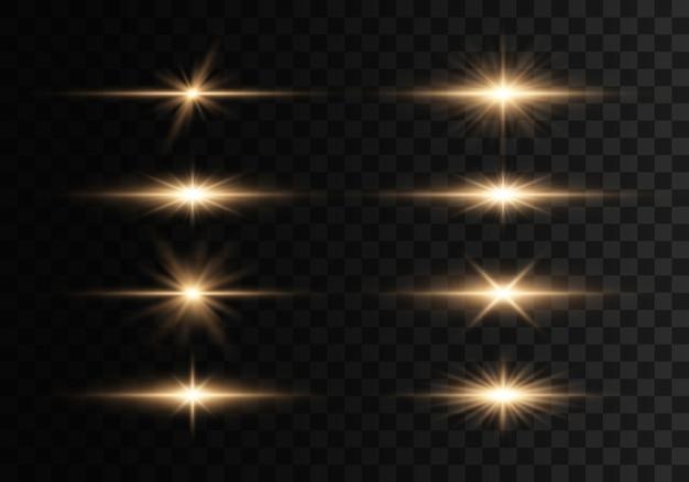 透明な背景に点滅、ライト、輝きのセット。明るい金が光り輝きます。抽象的な黄金色のライトが分離されました。明るい光線。輝くライン。イラスト。