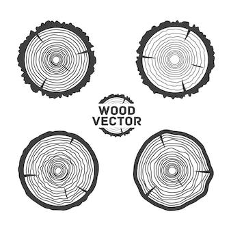 Комплект 4 черных изолированных предпосылки годичных колец и отрезанного ствола дерева. иллюстрация