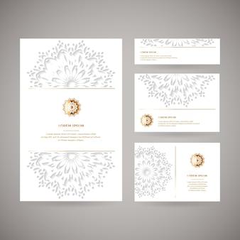 Набор из четырех декоративных золотых карточек с цветком восточной мандалы, свадебный шаблон, белый цвет. этнический старинный образец. индийский, азиатский, арабский, исламский, османский мотив.
