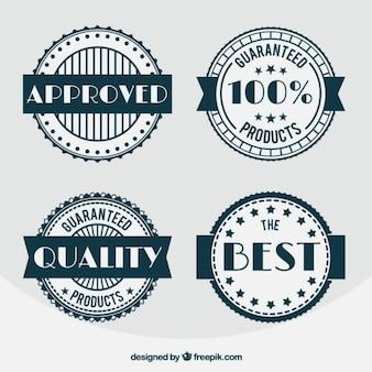 Набор из четырех старинных значков качества