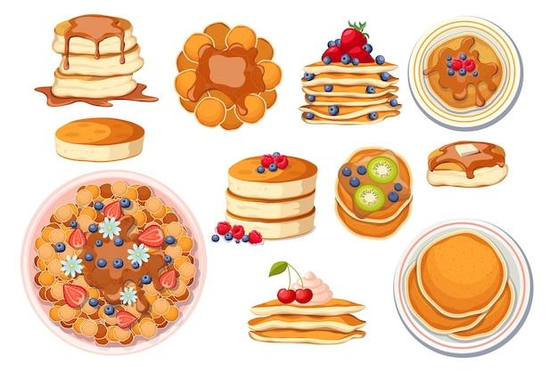 さまざまなトッピングの新鮮なホットパンケーキのセット。白い皿の上のパンケーキ、メープルシロップまたは蜂蜜で焼く、ベリー