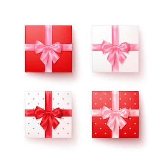Набор подарочных коробок с шелковыми бантами в реалистичном стиле сверху.