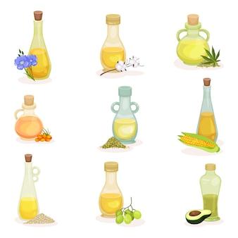 Набор стеклянных бутылок различных растительных масел. свежие и натуральные продукты. 100 органических ингредиентов