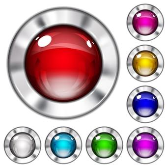 金属の境界線を持つさまざまな色のガラスまたはプラスチックのボタンのセット