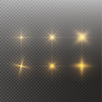 輝く光の効果のセットは、透明な背景の上で輝きとバーストを星します。透明な星。