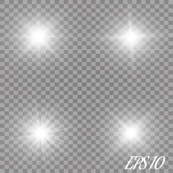 Набор светящихся световых эффектов с прозрачностью изолированы. блики, лучи, звезды