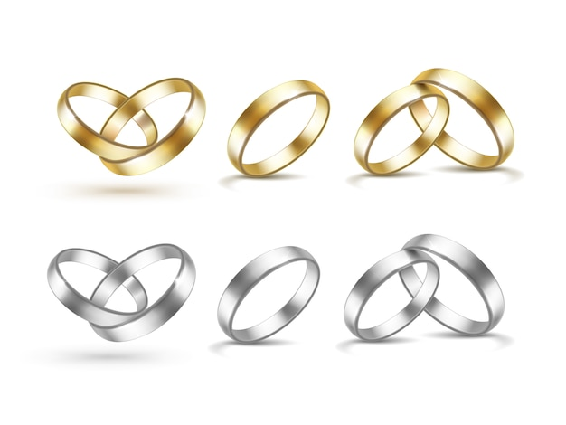 Набор золотых и серебряных обручальных колец, изолированных на белом