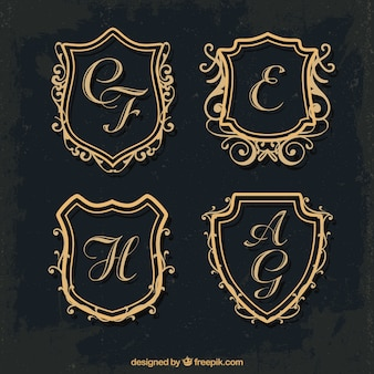 Set of gold shield monograms