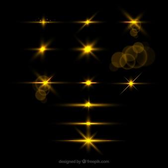 現実的なスタイルの金色のレンズフレアのセット