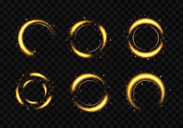 황금 반지 세트입니다. 반짝이 조명 효과와 골드 서클 프레임.