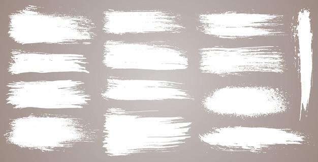グランジ芸術的なブラシストローク、ブラシのセット。創造的なデザイン要素。グランジ水彩広いブラシストローク。白い背景で隔離の白いコレクション