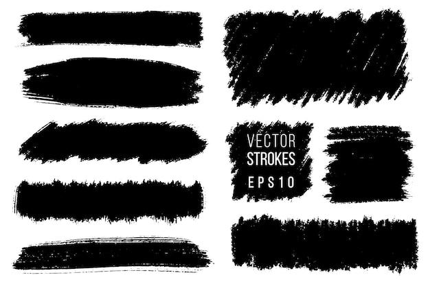 手描きのブラシストローク、背景の汚れのセット。モノクロ要素セット。単色の芸術的な手描きの背景。