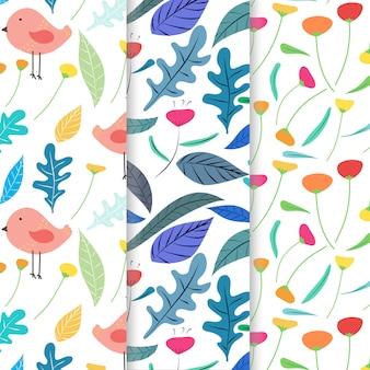 손으로 그린 귀여운 새와 꽃 패턴 배경 세트.