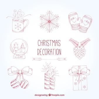 装飾的なクリスマスの要素を描かれた手のセット