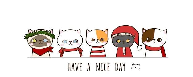 글자와 크리스마스 의상을 입고 손으로 그린 낙서 귀여운 고양이 세트