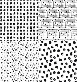 抽象的なデザインで手描きのシームレスなパターンのセット。
