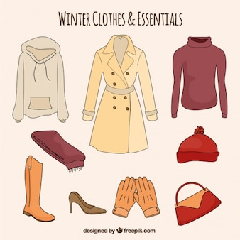 Set of hand drawn winter clothes and essentials