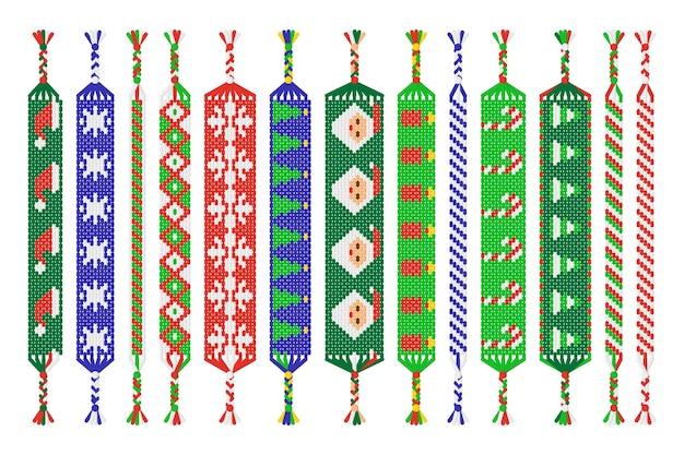 白い背景で隔離のスレッドの手作り友情ブレスレットのセット。クリスマスと新年あけましておめでとうございます