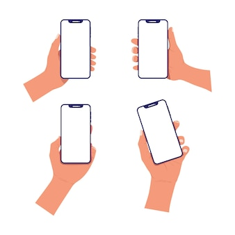 空白の白い画面でスマートフォンを保持している手のセット
