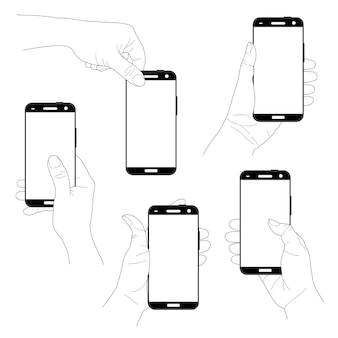 分離された垂直のモダンな黒のスマートフォンを持つ手のセット