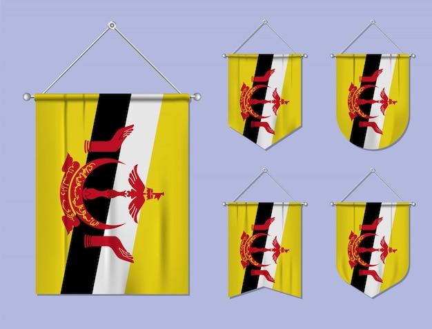 Набор висящих флагов брунея с текстильной текстурой. разнообразие форм национального флага страны. вертикальный шаблон вымпела.