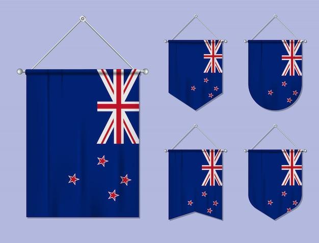 Набор висящих флагов новой зеландии с текстильной текстурой. разнообразие форм национального флага страны. вертикальный шаблон вымпела