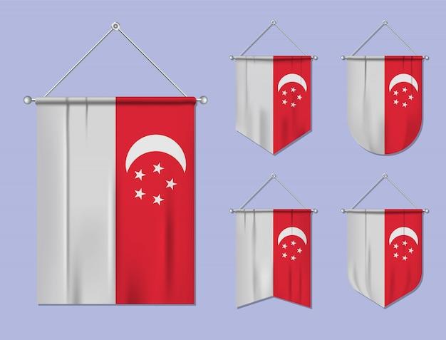Набор висящих флагов сингапур с текстильной текстурой. разнообразие форм национального флага страны. вертикальный шаблон вымпела.