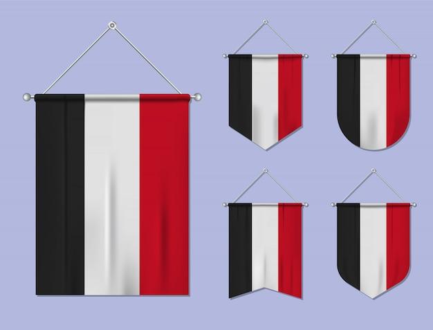 掛かる旗のセット繊維の質感とイエメン。国旗の国の多様性の形。垂直テンプレートペナント。
