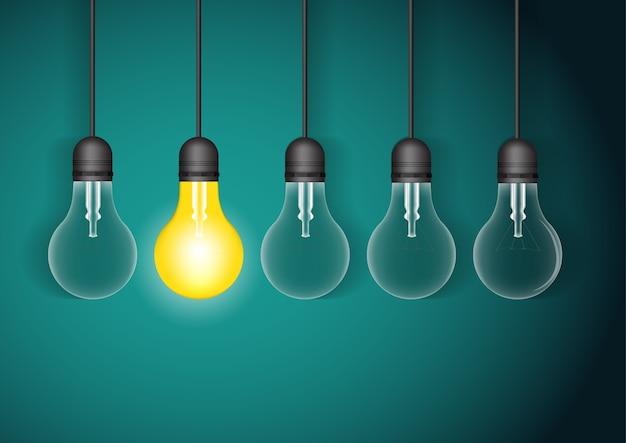 1つの光るぶら下がっている電球のセット。アイデアのコンセプトを持つ電球。