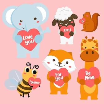 愛のグリーティングカードと漫画スタイルの幸せな動物のセットです。聖バレンタインの日を祝う 無料ベクター