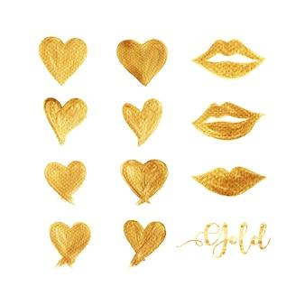 心と白い背景で隔離のゴールドカラーの唇のセット