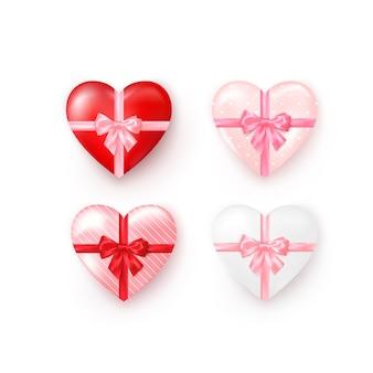 シルクの弓が付いているハート型のギフトボックスのセット。バレンタインデーのグリーティングカードテンプレート要素。