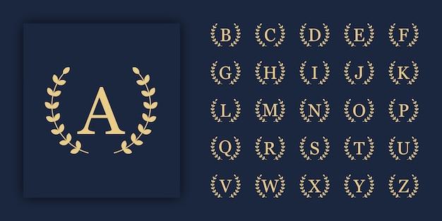 頭文字の豪華な飾りロゴのセット。装飾的な葉のセット。