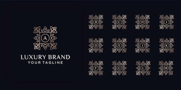초기 편지 럭셔리 장식 모노그램 로고 세트. 럭셔리 골드 초기 알파벳 로고 템플릿