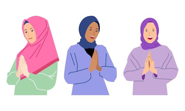 イスラムの女性のセットはヒジャーブを着用します