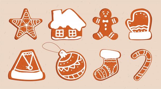 착 빙 및 다른 모양 및 요소의 설탕을 입힌 격리 된 생강 쿠키의 집합입니다. 새해와 크리스마스 차 쿠키.