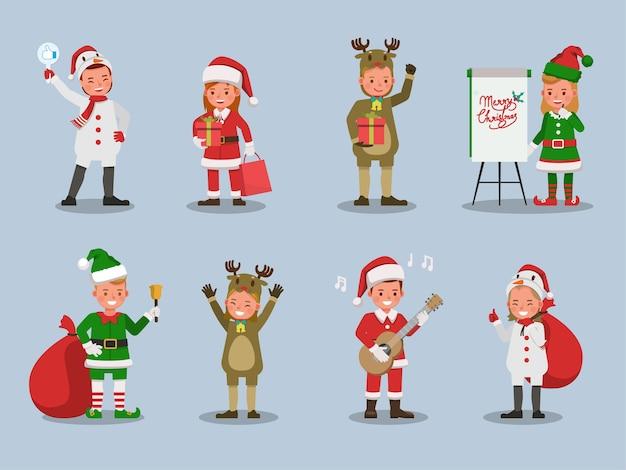クリスマスの衣装のキャラクターを身に着けている子供の男の子と女の子のセット