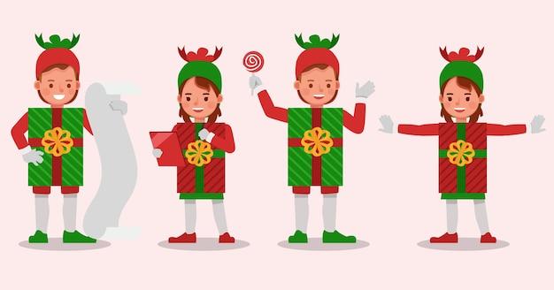 クリスマスギフトボックスの衣装のキャラクターを身に着けている子供の男の子と女の子のセット