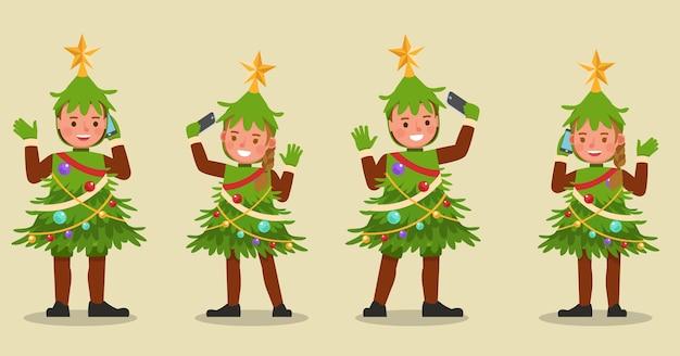 クリスマスツリーの衣装のキャラクターを身に着けている子供の男の子と女の子のセット