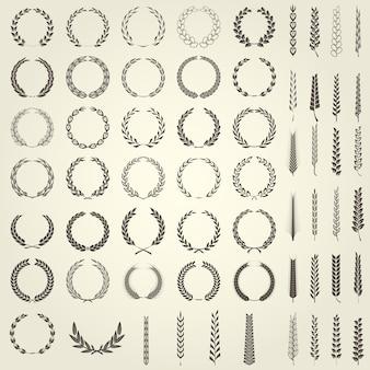 月桂樹の花輪と紋章のスタイルで小麦の耳のセット
