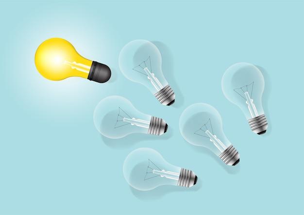 1つの光る電球を置くことのセット。電球のアイデアの創造的なコンセプト。
